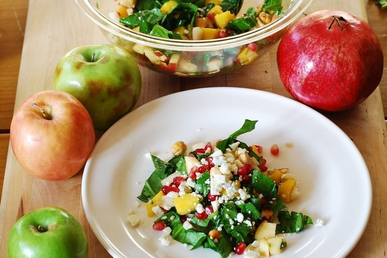 Chopped salad with apples, pears, mango, spinach, hazelnuts, andpomegranates 1