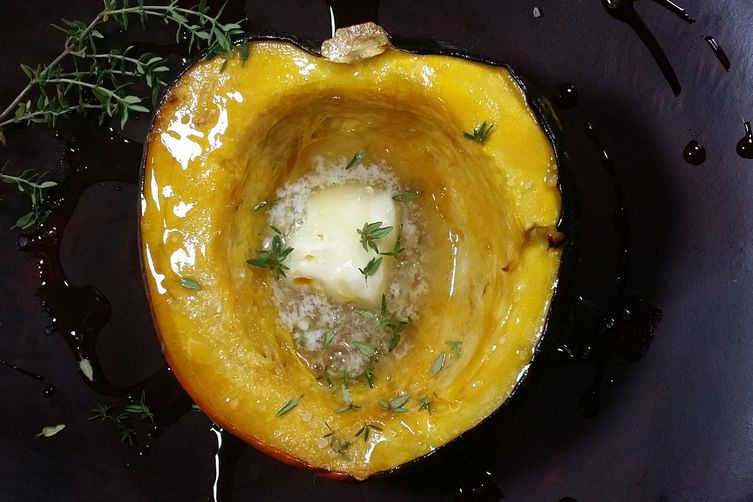 Baked acorn squash with butter, maple syrup andthyme 1