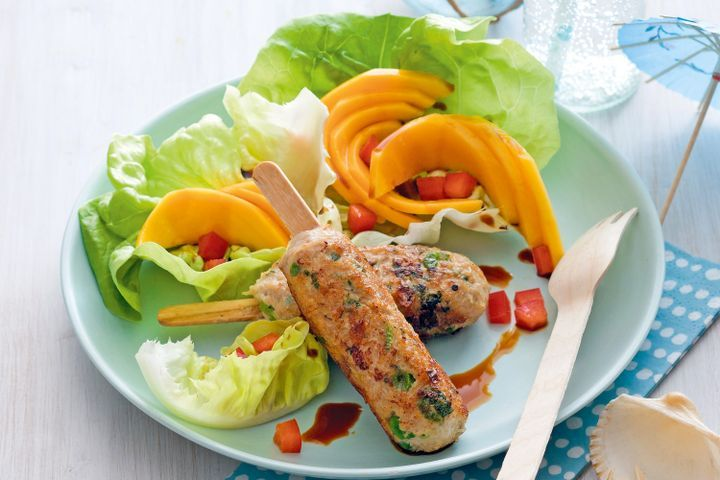 Barbecued chicken on a stick with mango salad 1
