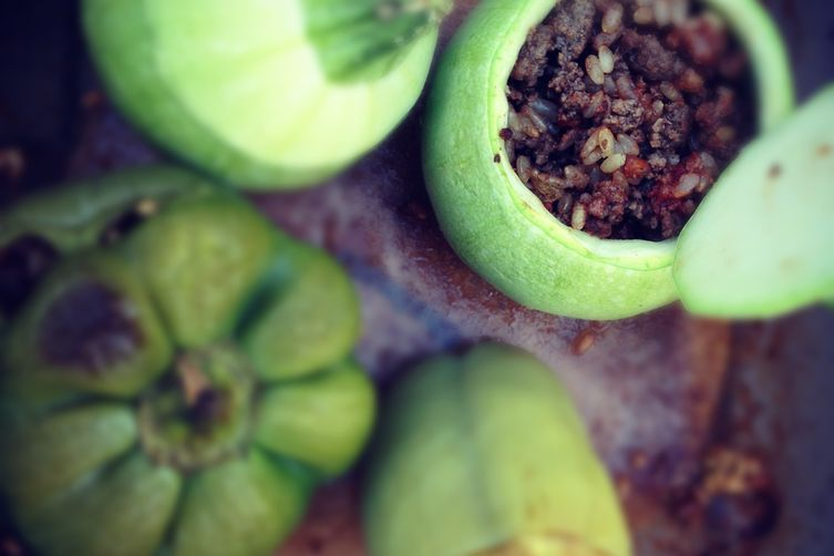 Green peppers and summer squash stuffed with ground beef, rice andspices 1